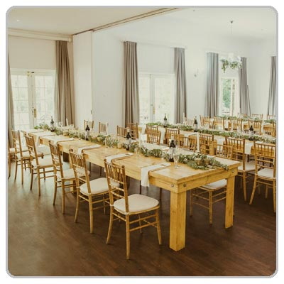 pallet wood banquet table with golden tiffany chairs